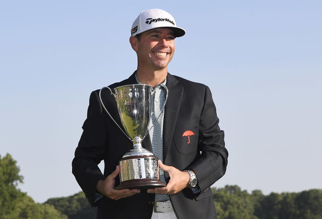 Chez Reavie, winner of the Travelers Championship golf tournament poses with the trophy, Sunday, June 23, 2019, in Cromwell, Conn. (AP Photo/Jessica Hill)