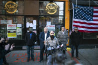 Danny Presti, center, a co-owner of Mac's Public House, speaks during a press conference outside the closed bar that was defying coronavirus restrictions on Staten Island Monday, Dec 7, 2020, in New York. Authorities in New York City said Presti was arrested early Sunday, Dec. 6 after running over a deputy with his car. (AP Photo/Eduardo Munoz Alvarez)