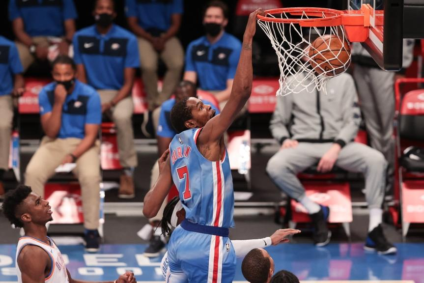 Kevin Durant dunking in Nets retro jersey