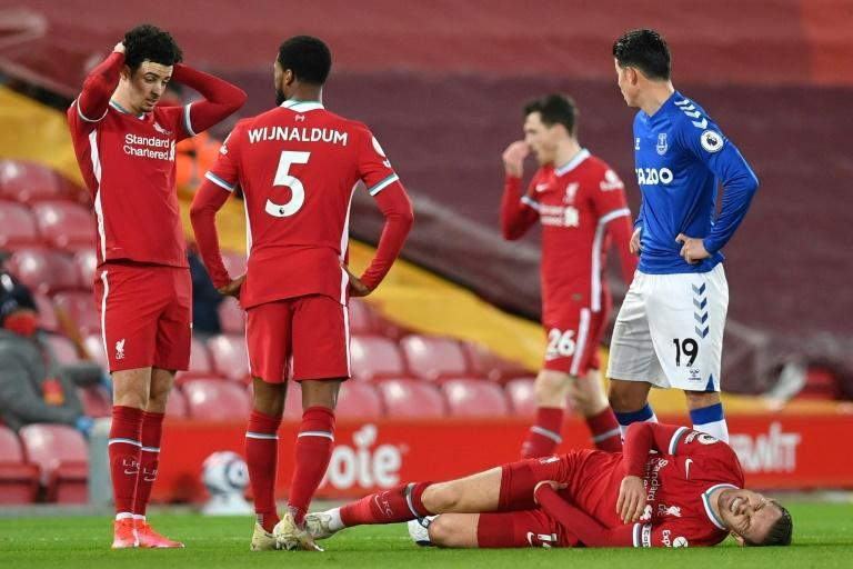 Fallen captain: Jordan Henderson (bottom right)is the latest key Liverpool player to suffer an injury
