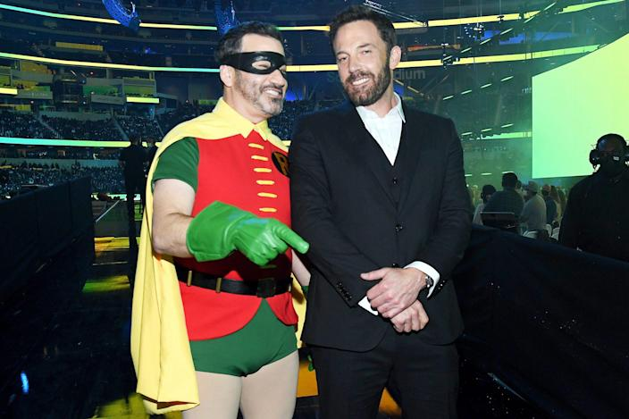 <p>Jimmy Kimmel, dressed as Robin, and Ben Affleck chat backstage at Global Citizen <em>Vax Live: The Concert to Reunite the World</em> at SoFi Stadium in Inglewood, California on Sunday.</p>