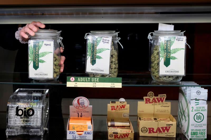 FILE PHOTO: An employee holds a jar of marijuana on sale at the Greenstone Provisions in Ann Arbor