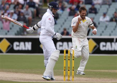 Australia's Ryan Harris (R) celebrates after taking the wicket of England's Graeme Swann during the fifth day's play in the second Ashes cricket test at the Adelaide Oval December 9, 2013. REUTERS/David Gray