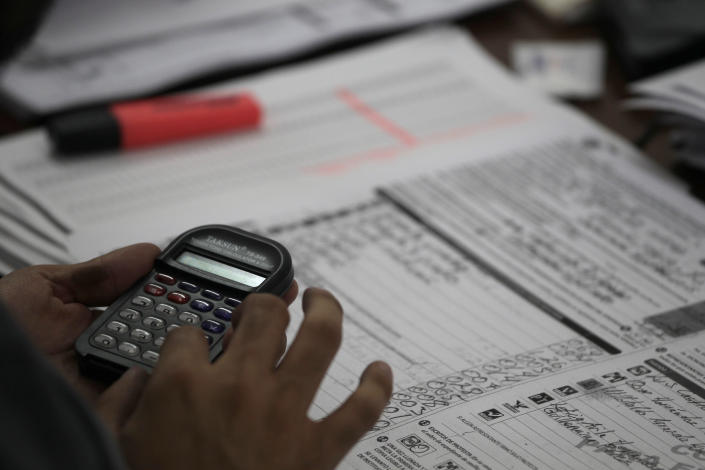 A party representative participates in the computation of ballot boxes at an electoral institute district council in Mexico City, Wednesday, July 4, 2012. The computation is done to determine which ballot boxes used in last Sunday's general elections will be recounted in front of party representatives. (AP Photo/Dario Lopez-Mills)