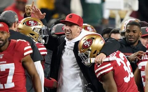 San Francisco 49ers head coach Kyle Shanahan, center, celebrates with players during the second half of the NFL NFC Championship football game against the Green Bay Packers Sunday, Jan. 19, 2020, in Santa Clara, Calif. The 49ers won 37-20 to advance to Super Bowl 54 against the Kansas City Chiefs.  - Credit: AP