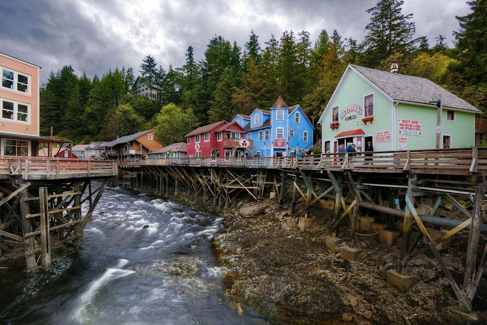 """<p>Although <a href=""""http://creekstreetketchikan.com"""" rel=""""nofollow noopener"""" target=""""_blank"""" data-ylk=""""slk:Creek Street"""" class=""""link rapid-noclick-resp"""">Creek Street</a> was once what is politely referred to as a red light district, it currently serves as a scenic boardwalk with quaint tourist spots. Visitors of this beautiful and historic walkway can spot wildlife (think otters, eagles, and large schools of salmon) and browse quaint shops and galleries along the way.</p>"""