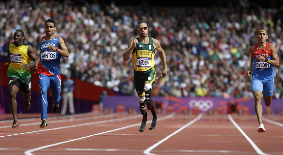 South Africa's Oscar Pistorius, center, leads Jamaica's Rusheen McDonald, left, Dominican Republic's Luguelin Santos, second left and Russia's Maksim Dyldin, right, in a men's 400-meter heat during the athletics in the Olympic Stadium at the 2012 Summer Olympics, London, Saturday, Aug. 4, 2012.(AP Photo/Anja Niedringhaus)
