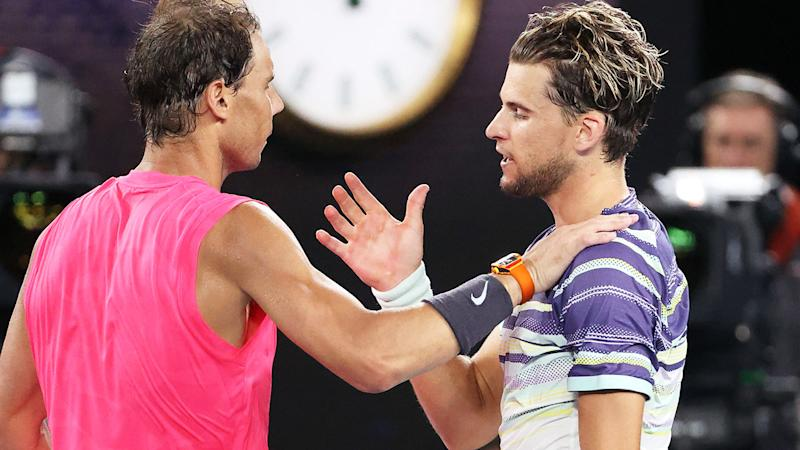 Rafael Nadal, pictured here embracing Dominic Thiem after their match at the Australian Open.