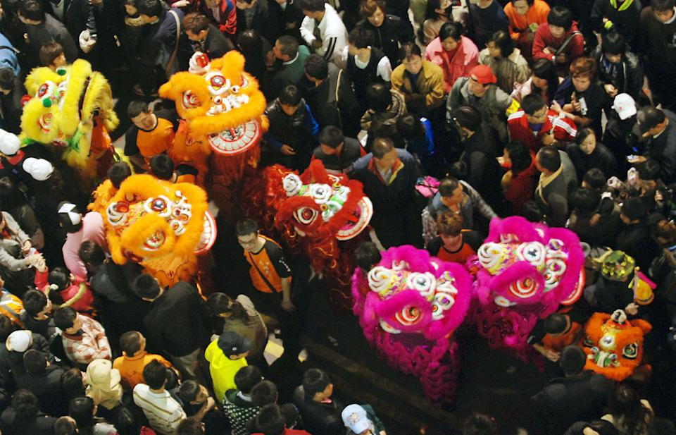 Surrounded by thousands of worshippers, lion dancers perform before the start of the Dajia Mazu Pilgrimage Trip early Saturday morning, April 17, 2010, in Dajia, on the central east coast of Taiwan. The effigy of Mazu and many thousands of followers will travel some 280 kilometers (174 miles) to sister Mazu temples, at the Dajia Jenn Lann Temple, . Mazu is said to protect fishermen and sailors and widely worshiped in the south-eastern coastal areas of China and neighbouring areas in Southeast Asia, all of which have strong sea-faring traditions.(AP Photo/Chiang Ying-ying)