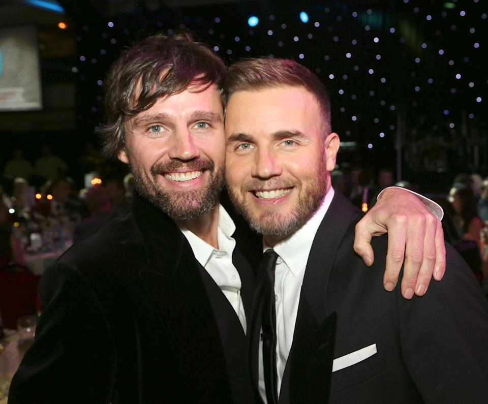 FILE - Jason Orange, left, and Gary Barlow seen at the 2012 Music Industry Trusts Award ceremony at the Grosvenor House Hotel on Monday, Nov. 5, 2012, in London. (Photo by John Marshall JM Enternational/Invision/AP)