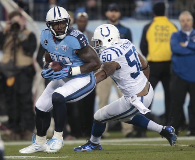 Tennessee Titans tight end Delanie Walker (82) moves past Indianapolis Colts inside linebacker Jerrell Freeman (50) in the first quarter of an NFL football game Thursday, Nov. 14, 2013, in Nashville, Tenn. (AP Photo/Wade Payne)