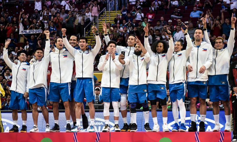 Players of the Philippines celebrate on the podium after winning gold medal in the men's final basketball event at the SEA Games (South East Asian Games) in Manila on December 10, 2019. (Photo: SHERWIN VARDELEON/AFP via Getty Images)