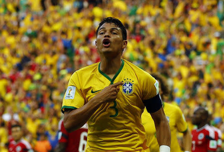 Brazil's Silva celebrates after scoring against Colombia during their 2014 World Cup quarter-finals at the Castelao arena in Fortaleza