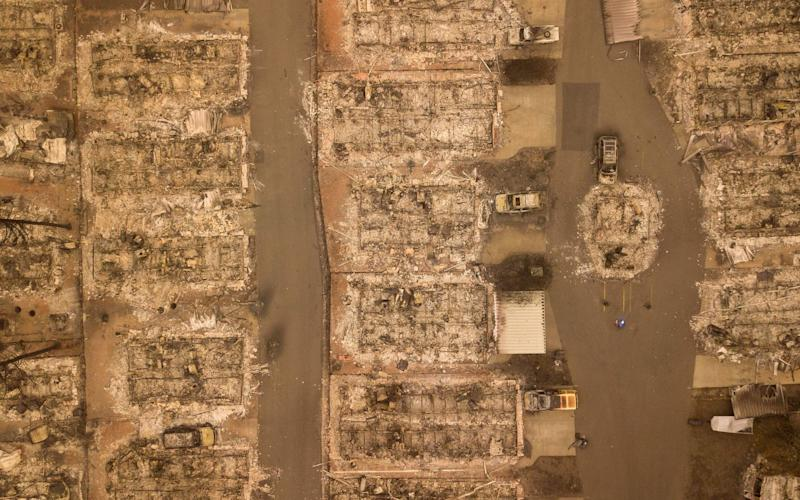 In this aerial photo, a burned neighborhood is seen in Paradise, California - AFP