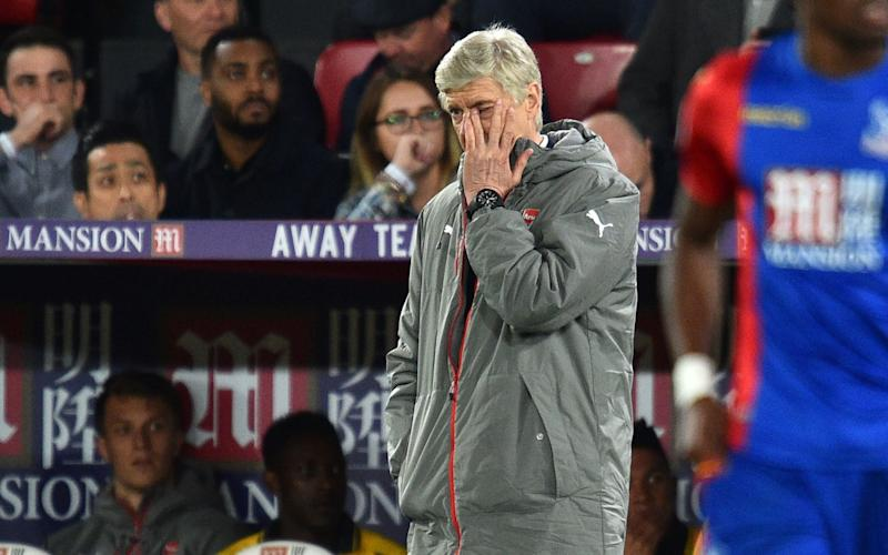 Arsene Wenger can barely bring himself to look - AFP