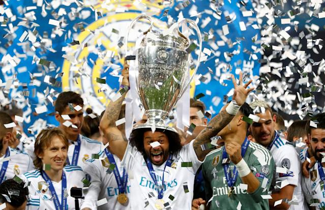 Soccer Football - Champions League Final - Real Madrid v Liverpool - NSC Olympic Stadium, Kiev, Ukraine - May 26, 2018 Real Madrid's Marcelo celebrates with the trophy after winning the Champions League REUTERS/Kai Pfaffenbach