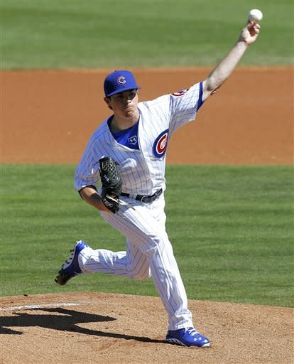 Chicago Cubs' Brooks Raley delivers a pitch against the Los Angeles Dodgers during the first inning of an exhibition spring training baseball game, Wednesday, Feb. 27, 2013, in Mesa, Ariz. (AP Photo/Matt York)