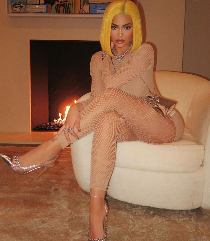 Kylie Jenner poses in a mesh bodysuit