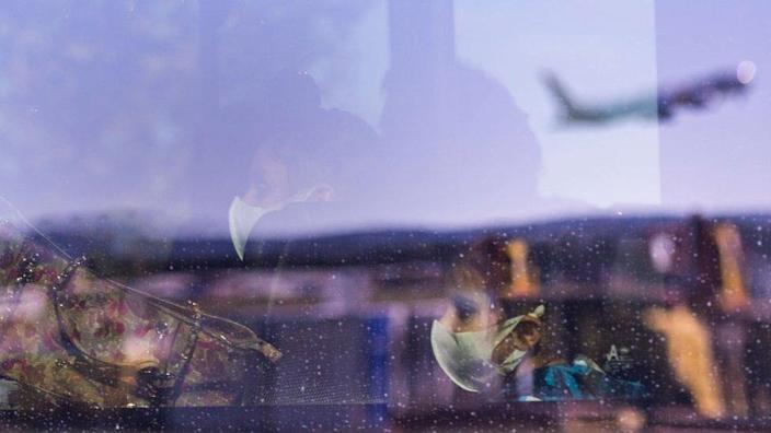 Passengers on a bus are seen after flying in from Delhi on May 15, 2020 in Canberra, Australia.