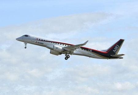 Mitsubishi Aircraft Corp's Mitsubishi Regional Jet (MRJ) takes off for a test flight at Nagoya Airfield in Toyoyama town, Aichi Prefecture, central Japan, in this photo taken by Kyodo November 11, 2015. Mandatory credit REUTERS/Kyodo