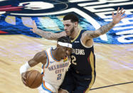 Oklahoma City Thunder guard Shai Gilgeous-Alexander (2) drives past New Orleans Pelicans guard Lonzo Ball (2) in the first quarter of an NBA basketball game in New Orleans, Wednesday, Jan. 6, 2021. (AP Photo/Derick Hingle)