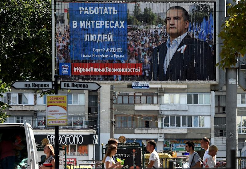 An election billboard in Simferopol promotes Crimean leader Sergei Aksyonov of the United Russia party, as seen on September 10, 2016 (AFP Photo/Vasily Maximov)