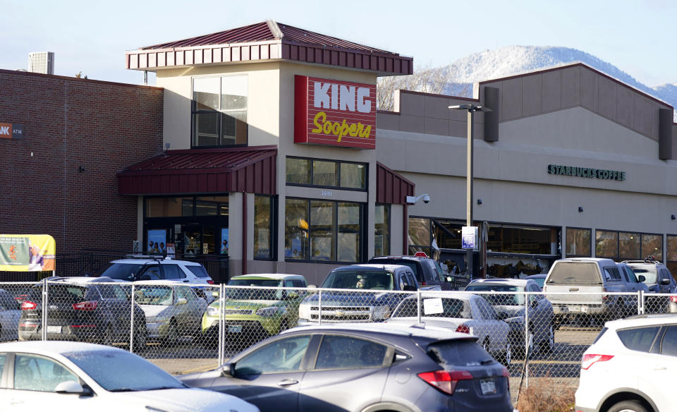 A makeshift fence stands around the parking lot outside a King Soopers grocery store where a mass shooting took place a day earlier in Boulder, Colo., Tuesday, March 23, 2021. (AP Photo/David Zalubowski)