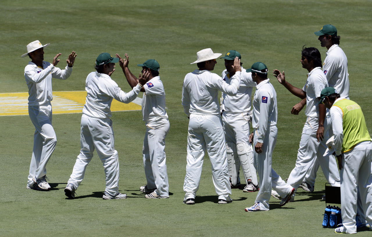 Pakistan cricket squad celebrates the dismissal of South African batsman AB de Villiers during the second day of the third Test match between South Africa and Pakistan on February 23, 2013 at Super Sport Park in Centurion. AFP PHOTO / STEPHANE DE SAKUTIN        (Photo credit should read STEPHANE DE SAKUTIN/AFP/Getty Images)