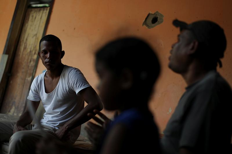 Raymond Acosta, a friend of the family of Maroly Bastardo, talks with Reuters at his house in Guiria, Venezuela, on May 24. (Photo: Ivan Alvarado/Reuters)