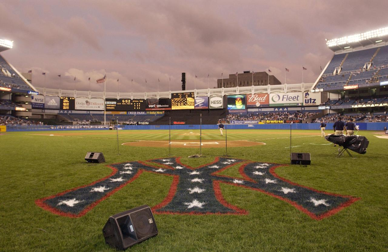 The New York Yankee symbol is painted red, white, and blue for the Yankees game against the Tampa Bay Devil Rays at Yankee Stadium September 25, 2001 in the Bronx, New York. This is the first baseball game played at Yankee stadium since the terrorist attack on the twin towers. (Photo by Ezra Shaw/Allsport/Getty Images)
