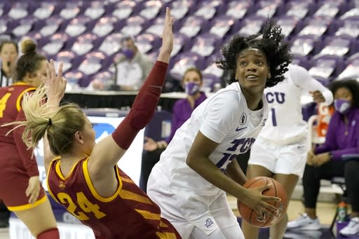 Iowa State guard Ashley Joens (24) is knocked backwards as TCU guard Tavy Diggs (13) positions for a shot in the second half of an NCAA college basketball game in Fort Worth, Texas, Wednesday, Dec. 2, 2020. (AP Photo/Tony Gutierrez)