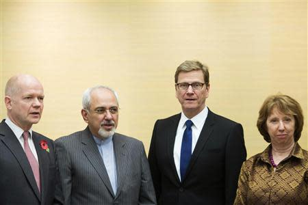 (L-R) British Foreign Secretary William Hague, Iranian Foreign Minister Mohammad Javad Zarif, Germany's Foreign Minister Guido Westerwelle and EU foreign policy chief Catherine Ashton attend the third day of closed-door nuclear talks at the Intercontinental Hotel in Geneva November 9, 2013. REUTERS/Jean-Christophe Bott/Pool