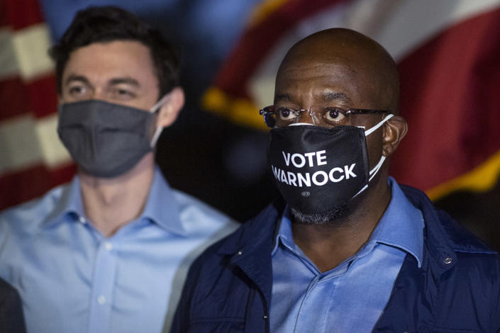 Democratic candidates for Georgia senate Rev. Raphael Warnock, right, and Jon Ossoff, attend a drive-in rally with Muscogee County Democrats at the Civic Center in Columbus, Ga. (Photo By Tom Williams/CQ-Roll Call, Inc via Getty Images)