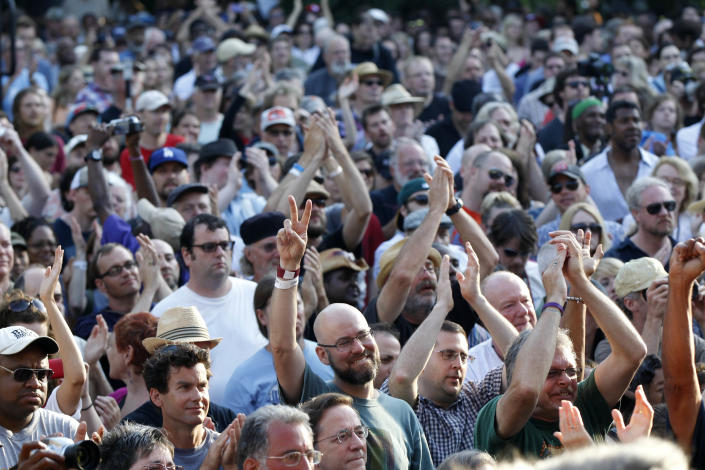 People in the crowd cheer at a sunrise concert marking International Jazz Day in New Orleans, Monday, April 30, 2012. The performance, at Congo Square near the French Quarter, is one of two in the United States Monday; the other is in the evening in New York. Thousands of people across the globe are expected to participate in International Jazz Day, including events in Belgium, France, Brazil, Algeria and Russia. (AP Photo/Gerald Herbert)