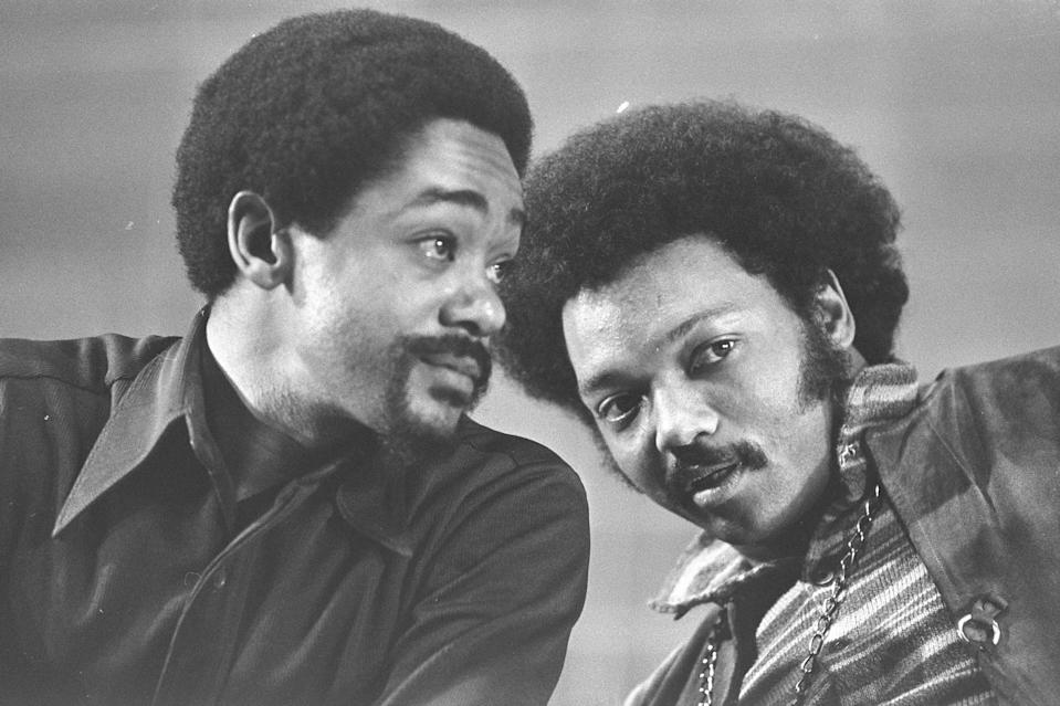 FILE - In this March 12, 1972, file photo, Bobby Seale, left, and the Rev. Jesse Jackson talk at the National Black Political Convention in Gary, Ind. Thousands of Black activists from across the U.S. will hold the 2020 Black National Convention on Aug. 28, 2020, via livestream to produce a new political agenda that builds on the protests that followed George Floyd's death. Convention organizers said this year's event will pay tribute to the historic 1972 National Black Political Convention. (AP Photo/File)