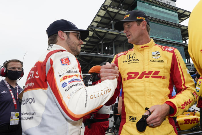 Marco Andretti, left, talks with Ryan Hunter-Reay during qualifications for the Indianapolis 500 auto race at Indianapolis Motor Speedway, Saturday, May 22, 2021, in Indianapolis. (AP Photo/Darron Cummings)