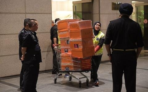Malaysian police seize a huge haul of handbags belonging to Najib Razak's wife - Credit: Ariffin Jamar/AFP