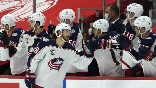 Columbus Blue Jackets right wing Oliver Bjorkstrand (28) celebrates his goal against the Detroit Red Wings in the second period of an NHL hockey game Monday, Jan. 18, 2021, in Detroit. (AP Photo/Paul Sancya)