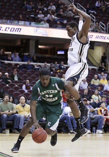 Eastern Michigan's Anthony Strickland, left, drives past Western Michigan's Darius Paul in the first half during an NCAA college basketball game at the Mid-American Conference men's tournament Thursday, March 14, 2013, in Cleveland. Western Michigan won 70-55. (AP Photo/Tony Dejak)