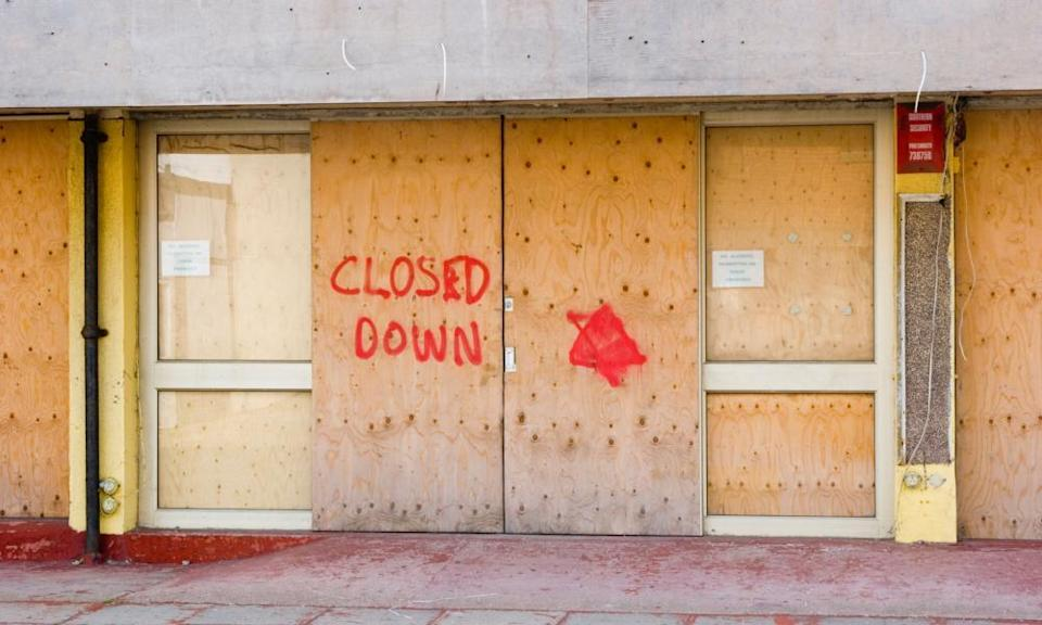 Shops closed down and boarded up