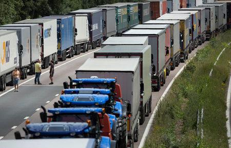 FILE PHOTO: Lorries are parked on the M20 motorway as park of Operation Stack in southern England