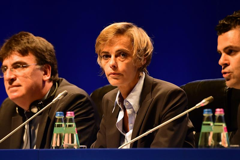 French Football Federation (FFF) director general, Florence Hardouin (L), UEFA governing body's interim general secretary Theodore Theodoridis (C) and UEFA's Chief of Press Pedro Pinto (R) react during the press conference after Hardouin's admission in UEFAs Executive Committee, at the 40th Ordinary UEFA Congress in Hungexpo Fair Center of Budapest on May 3, 2016. UEFA elected Hardouin as its first female executive member in a landmark vote. / AFP / ATTILA KISBENEDEK (Photo credit should read ATTILA KISBENEDEK/AFP via Getty Images)
