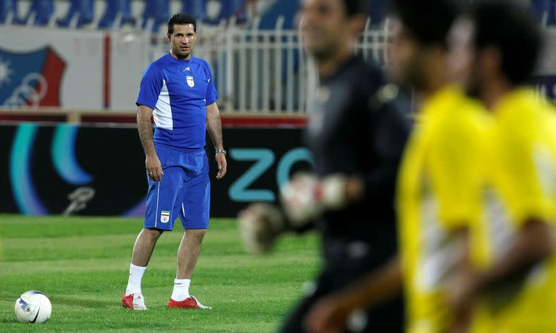 FILE PHOTO: Iran's national soccer team head coach Ali Daei watches his team during a training session one day ahead of their World Cup 2010 qualifying match against Kuwait, in Kuwait City