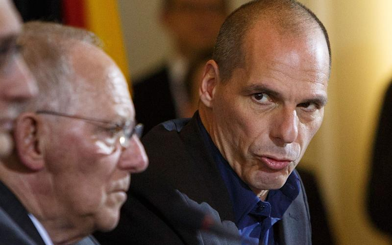 Yanis Varoufakis says France failed to stand up to with German Finance Minister Wolfgang Schaeuble (left) during the Greek dept crisis - Credit:  Carsten Koall/ Getty Images