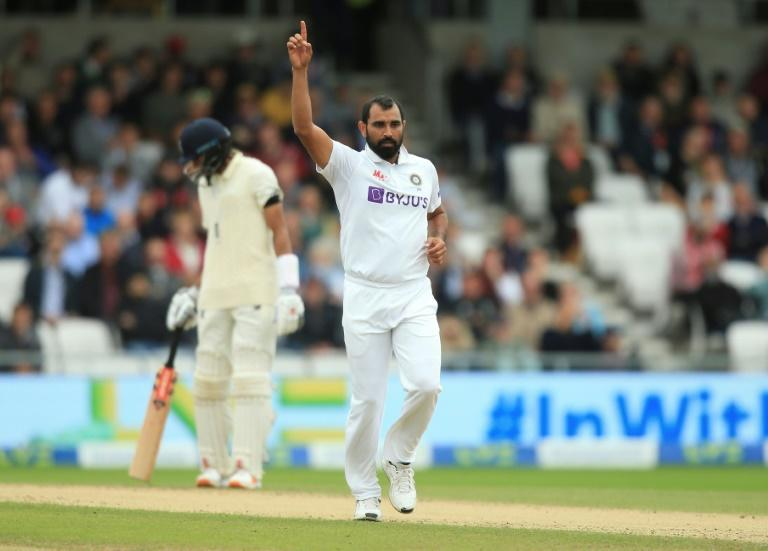 Success - India's Mohammed Shami (C) celebrates bowling out England's Rory Burns in the third Test at Headingley on Thursday