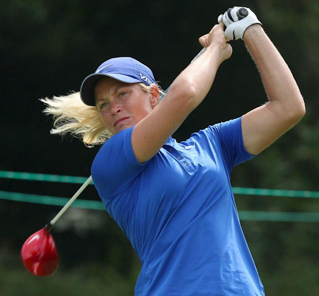 Suzann Pettersen, of Norway, watches her shot on the third hole during second round play at the Canadian Pacific Women's Open golf tournament in London, Ontario, Friday, Aug. 22, 2014. (AP Photo/The Canadian Press, Dave Chidley)