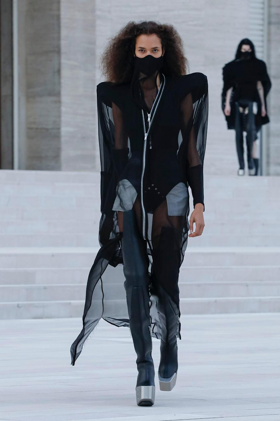 "<h2>Dark Times<br></h2><br>Brands like Rick Owens, Marine Serre, and Maison Margiela are known for their somewhat dystopian aesthetics, but, this season, things felt especially dark at their shows. The same went for Balenciaga and ROKH, too. And it should've. Things aren't going too well for the world right now, and while most designers this season spent their time in quarantine designing colourful, escapist collections full of bright prints and <a href=""https://www.refinery29.com/en-gb/women-loungewear-sets"" rel=""nofollow noopener"" target=""_blank"" data-ylk=""slk:high fashion loungewear"" class=""link rapid-noclick-resp"">high fashion loungewear</a>, we knew we could count on Demna Gvasalia, Rick Owens, and John Galliano, among others, to be straight with us — but to also do so in an exceptionally beautiful way. <br><br><em>Rick Owens</em><span class=""copyright"">Photo: OWENSCORP.</span>"