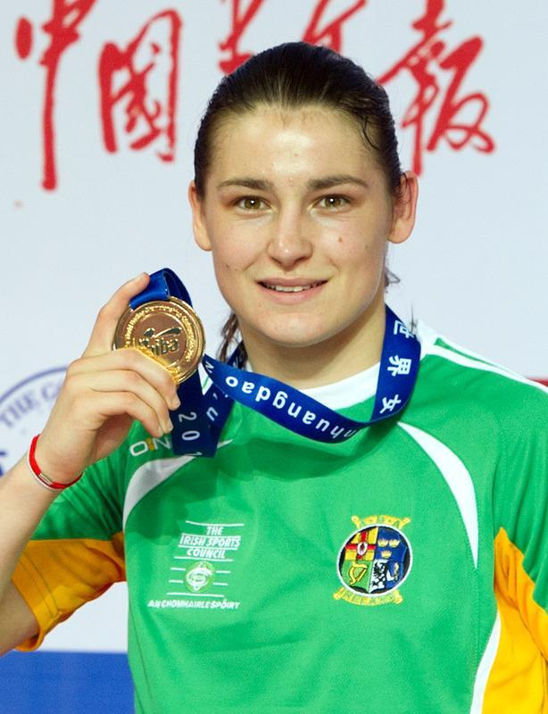 Gold medalist Katie Taylor of Ireland poses as she stands on the podium of the lightweight 60kg category at the Women's World Boxing Championships in Qinhuangdao on May 19, 2012. Eight places in the three Olympic weight categories, flyweight, lightweight and middleweight, are up for grabs at the world championships, with another four awarded to small and developing countries. AFP PHOTO / Ed JonesEd Jones/AFP/GettyImages