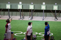 Christian Reitz, left, of Germany, Jongoh Jin, of South Korea, and Abhishek Verma, of India, compete in the men's 10-meter air pistol at the Asaka Shooting Range in the 2020 Summer Olympics, Saturday, July 24, 2021, in Tokyo, Japan. (AP Photo/Alex Brandon)