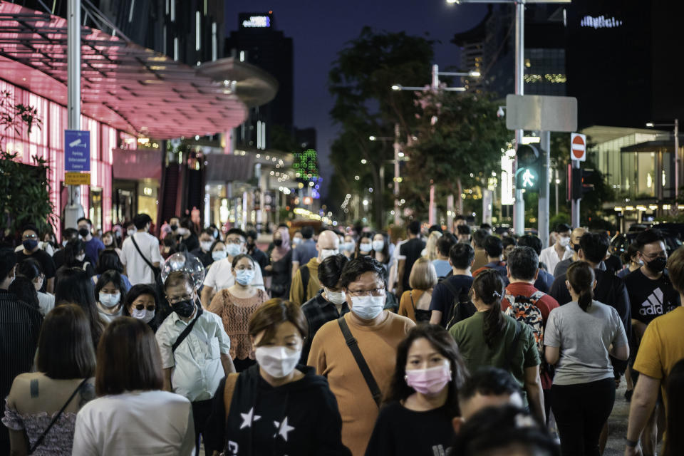 SINGAPORE - 2021/10/02: People wearing face masks as a preventive measure against the spread of covid-19 walk along Orchard Road, the famous shopping district. (Photo by Maverick Asio/SOPA Images/LightRocket via Getty Images)